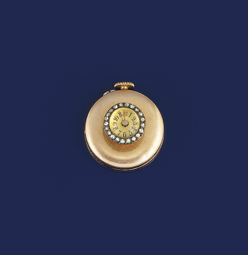 A gold and diamond miniature l
