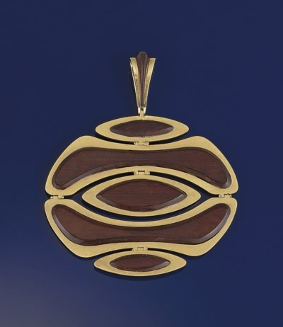 A rosewood pendant, by Van Cle