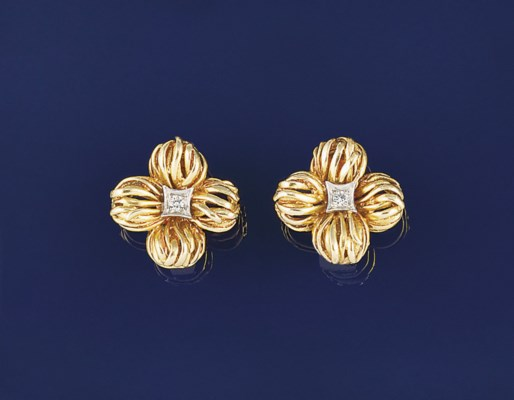 A pair of diamond earclips by