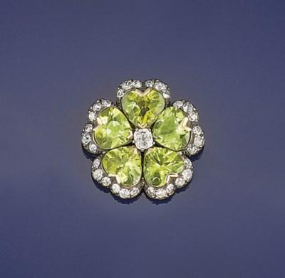 A peridot and diamond brooch