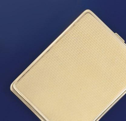 A 9ct. gold cigarette case for