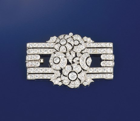 A diamond brooch/pendant