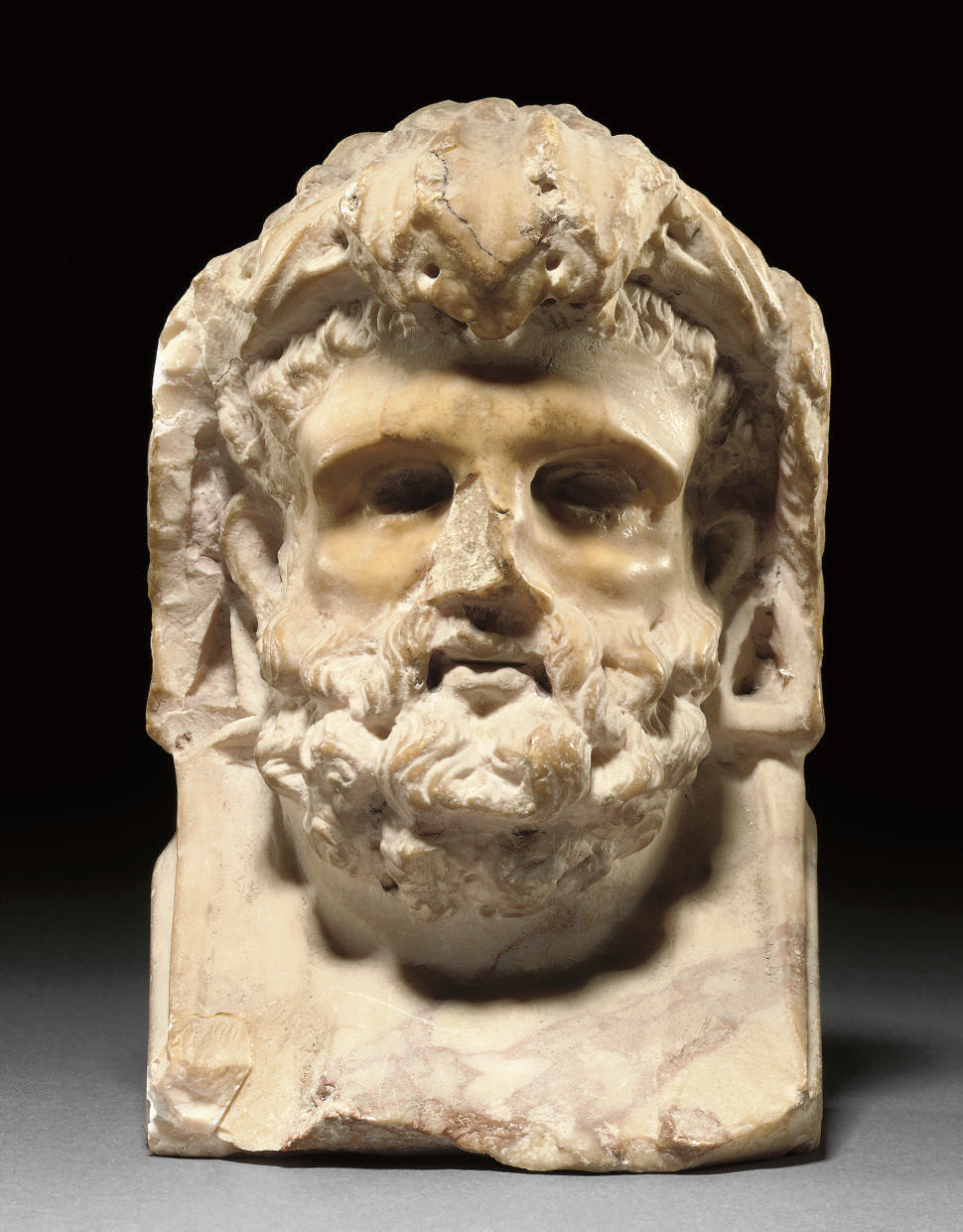 A ROMAN VEINED MARBLE HERM HEA