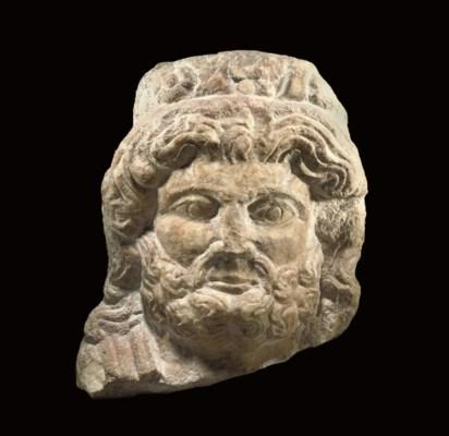 AN EAST ROMAN MARBLE HEAD OF J