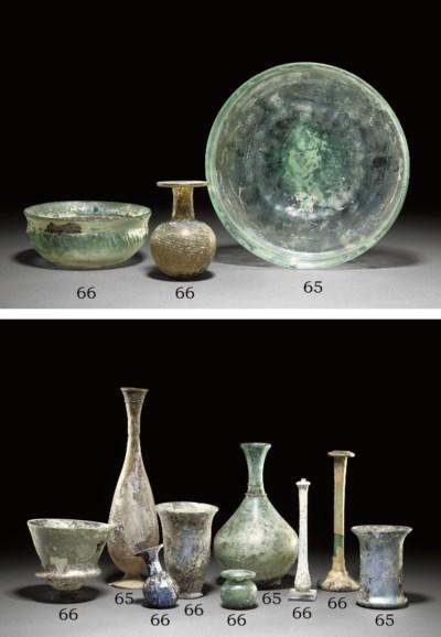 FOUR ROMAN GLASS VESSELS