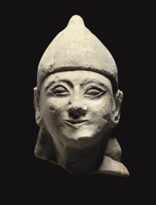 A CYPRIOT LIMESTONE HEAD OF A