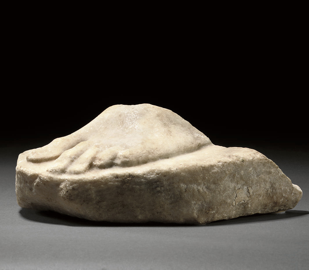 A ROMAN MARBLE FRAGMENT OF A F