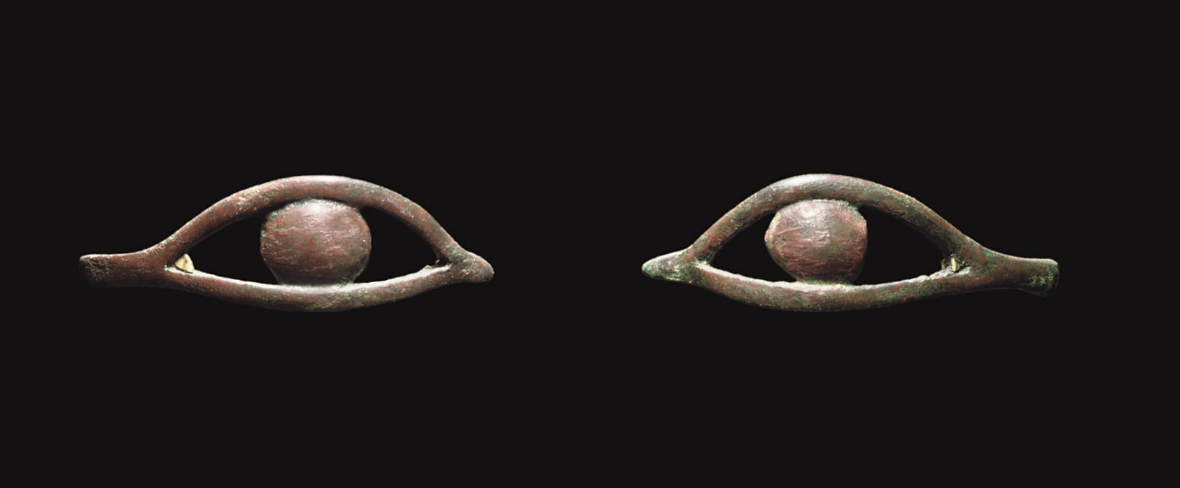 A PAIR OF EGYPTIAN BRONZE EYE
