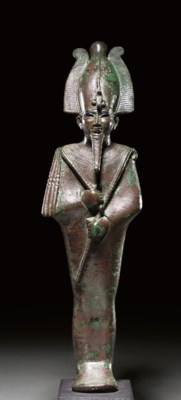 A LARGE EGYPTIAN BRONZE FIGURE