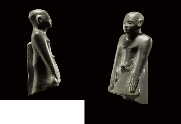 AN EGYPTIAN GREYWACKE FIGURE O