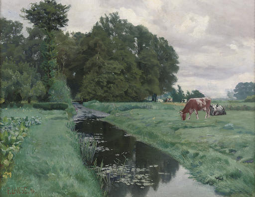 Cows grazing by a waterway
