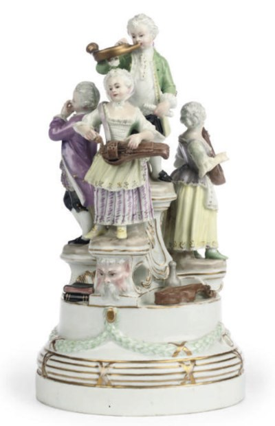 A GERMAN PORCELAIN GROUP OF MU