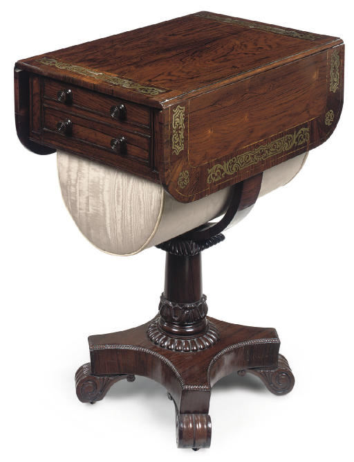 A REGENCY ROSEWOOD AND BRASS INLAID WORK TABLE