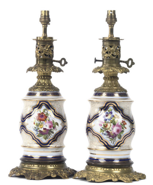 A PAIR OF LATE VICTORIAN POLYCHROME DECORATED PORCELAIN AND GILT BRASS TABLE LAMPS