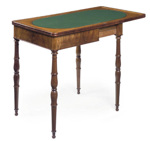 A CHARLES X WALNUT GAMES TABLE