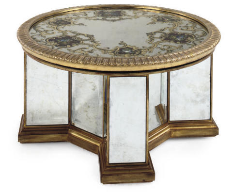 A GILTWOOD AND MIRRORED CIRCUL
