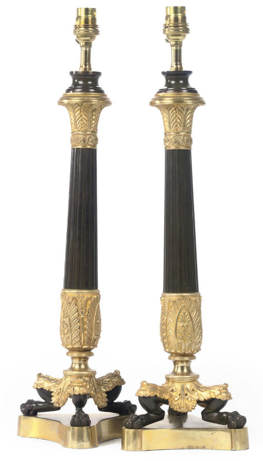 A PAIR OF PATINATED AND GILT BRONZE TABLE LAMPS