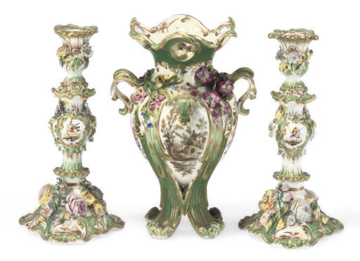 AN ENGLISH GREEN-GROUND TWO-HANDLED VASE AND A PAIR OF CANDLESTICKS