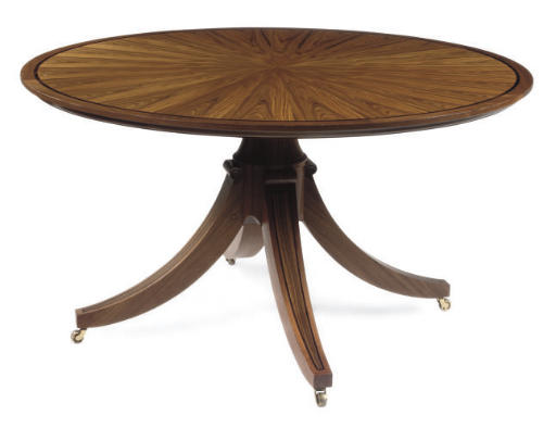 A WALNUT CIRCULAR DINING TABLE