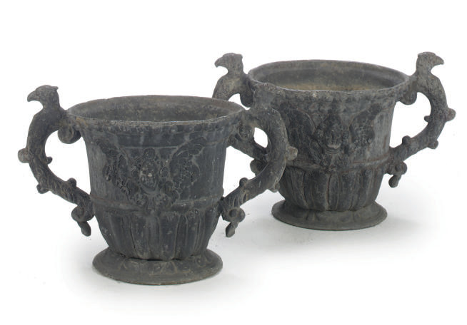 A PAIR OF EDWARDIAN LEAD TWO-H