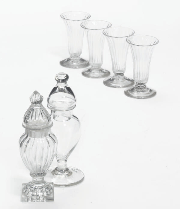 TWO CLEAR GLASS JARS AND COVER