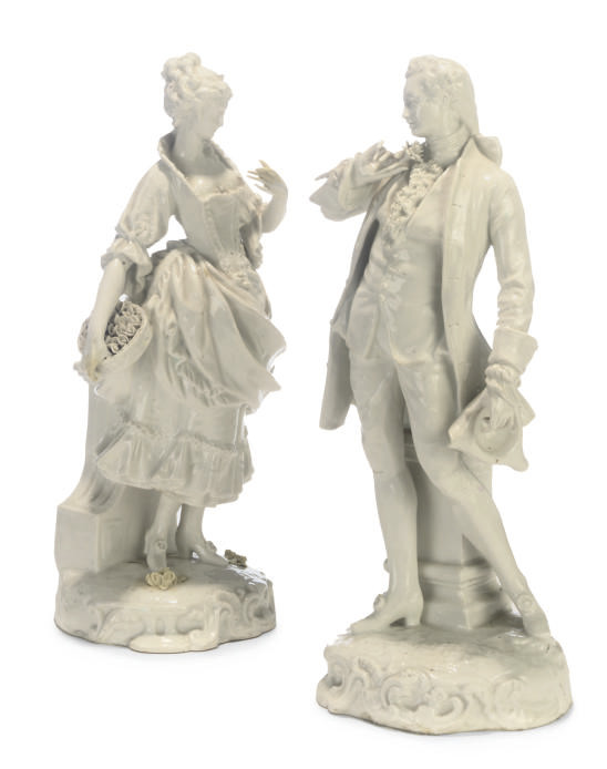 A PAIR OF CONTINENTAL WHITE PORCELAIN FIGURES OF A GALLANT AND A LADY