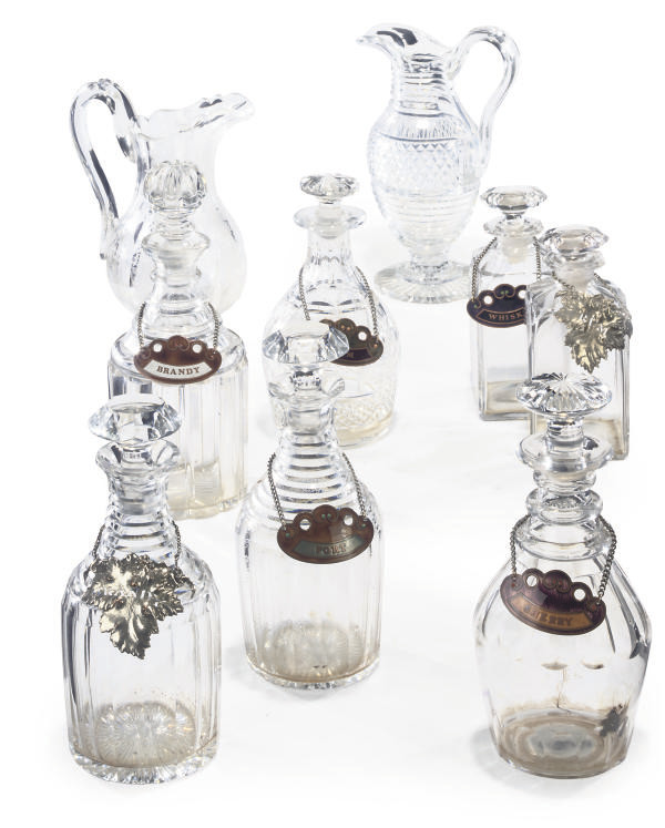 SEVEN CUT-GLASS DECANTERS AND