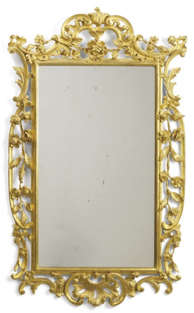 A CARVED GILTWOOD MIRROR