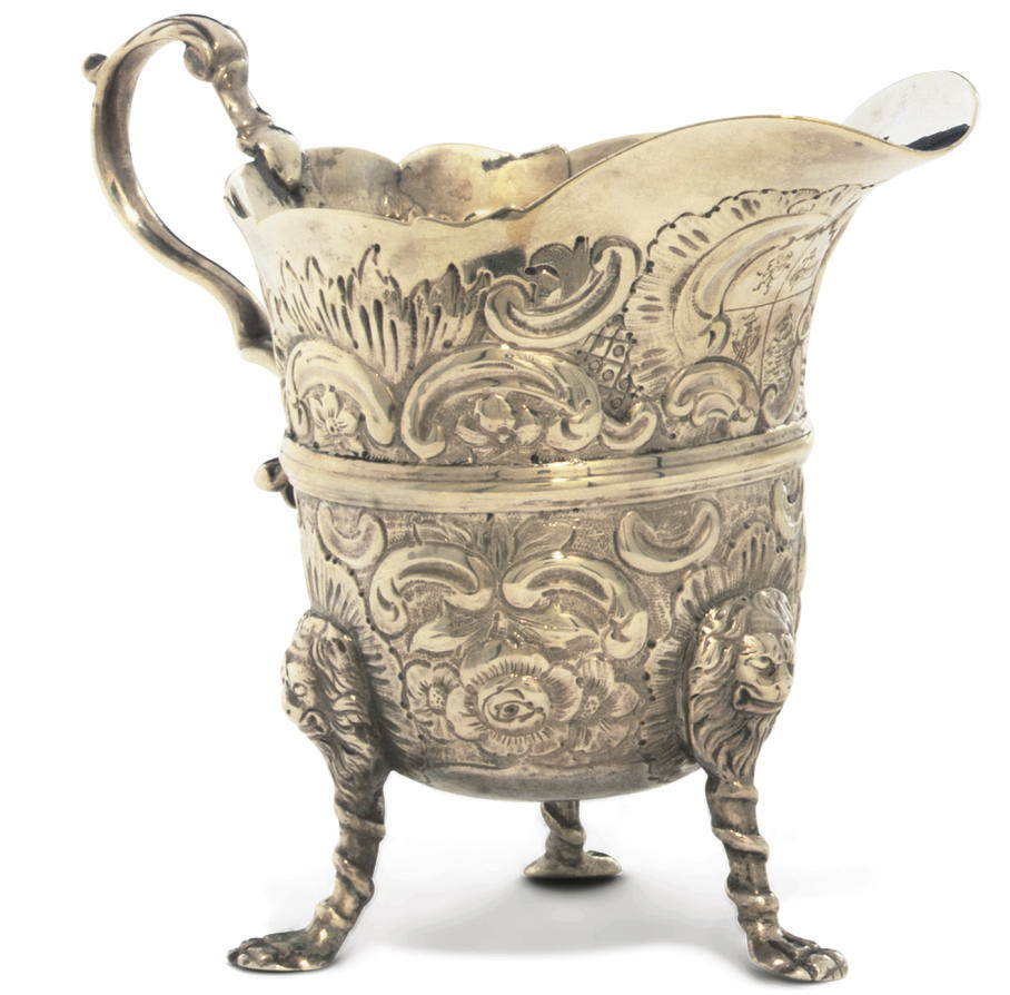 A GEORGE II IRISH SILVER CREAM JUG