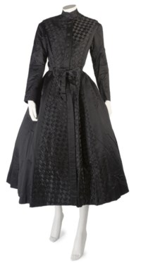 BALMAIN COUTURE, A FINE BLACK SILK COAT DRESS, CIRCA 1952