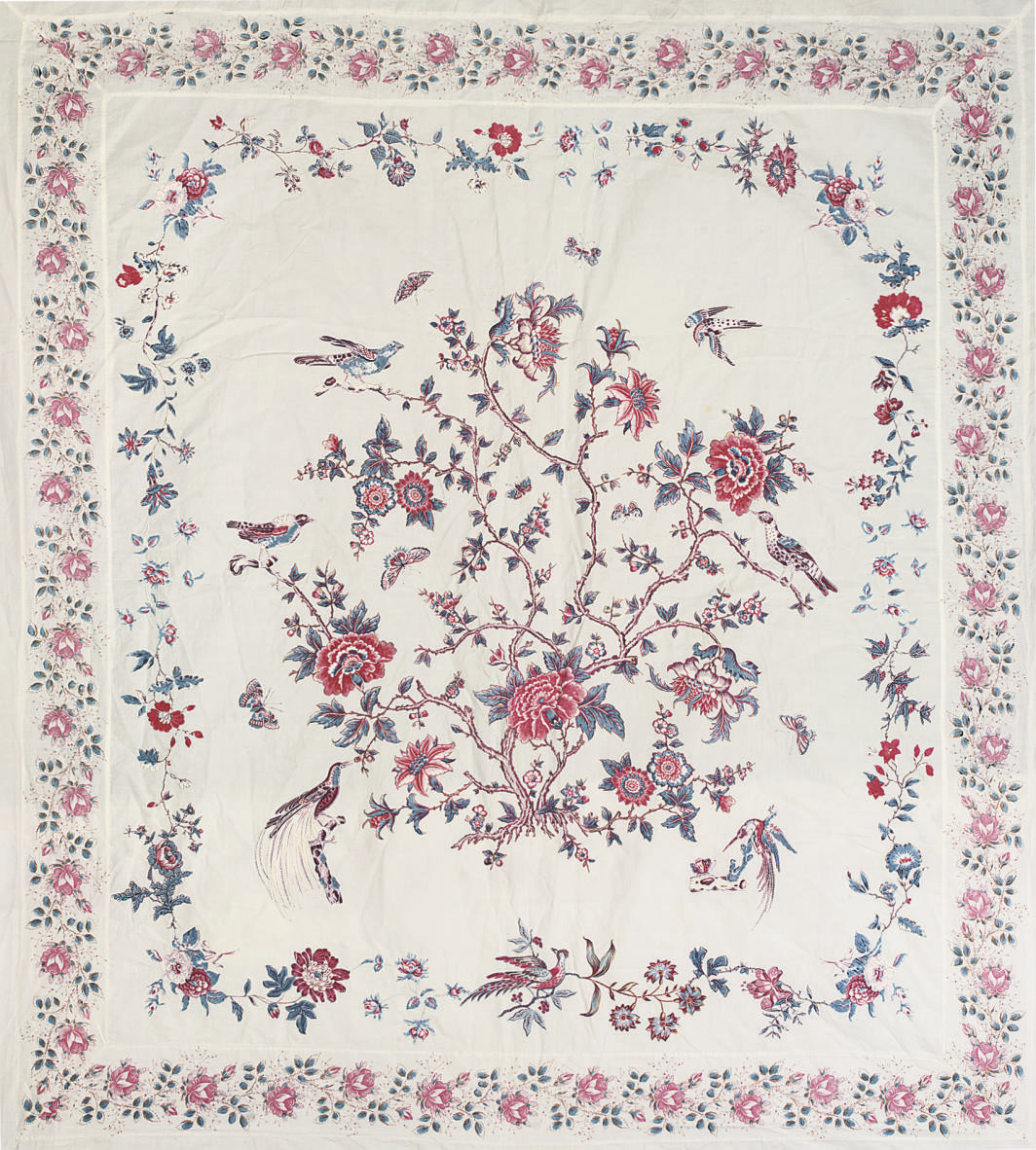 A FINE BRODERIE PERSE COVERLET