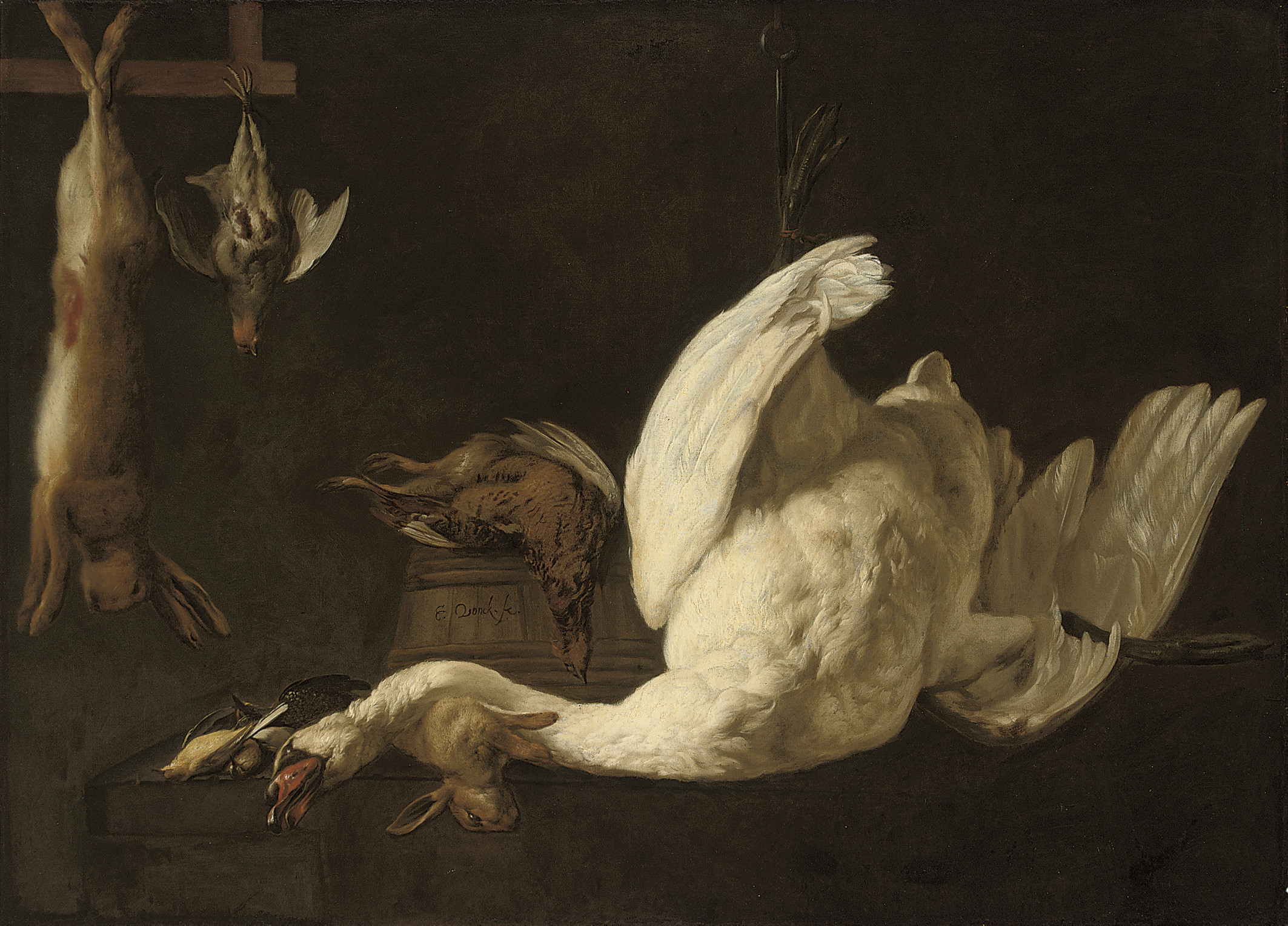 A still life of a swan suspended from a hook, a hare, a grey partridge, a pheasant on a barrel and a rabbit and song birds on a stone ledge