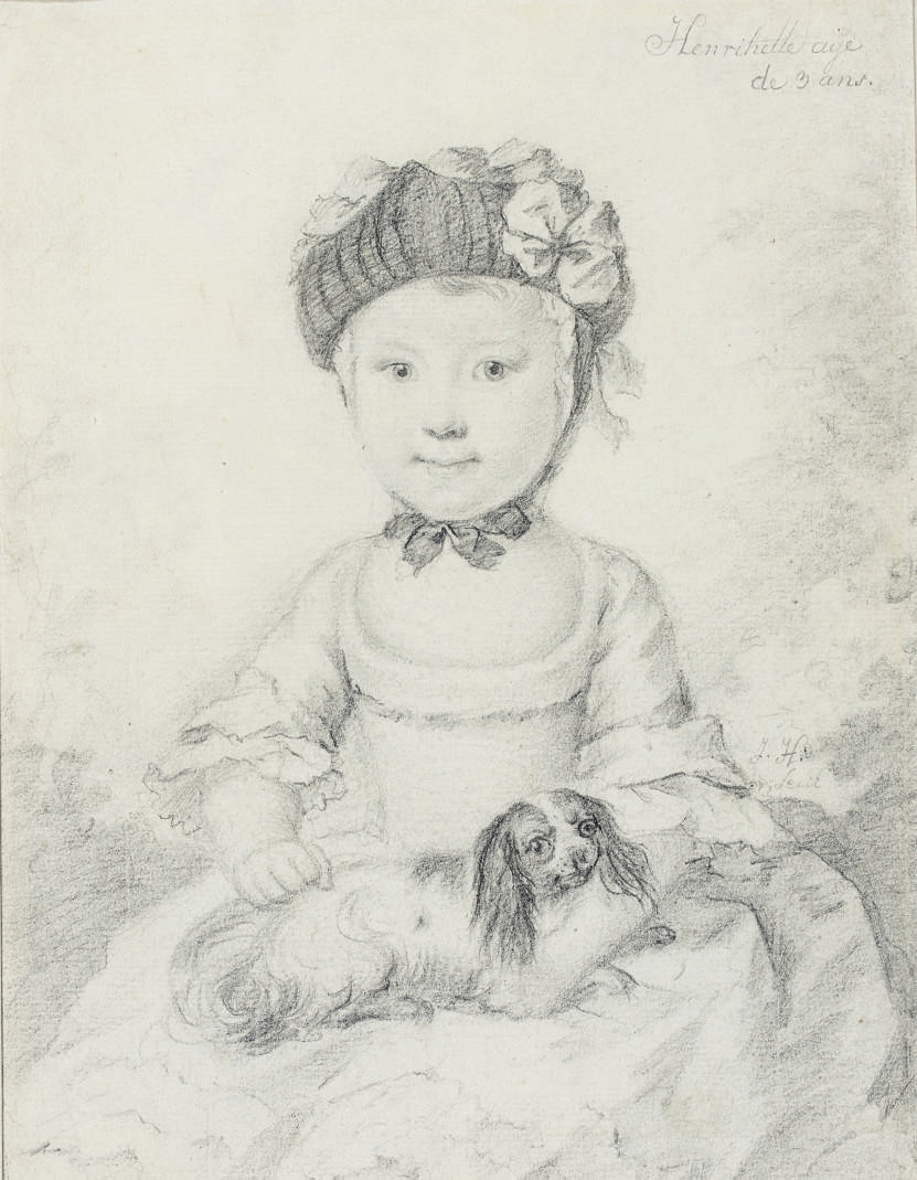 Portrait of a little girl seated with a cavalier spaniel on her lap