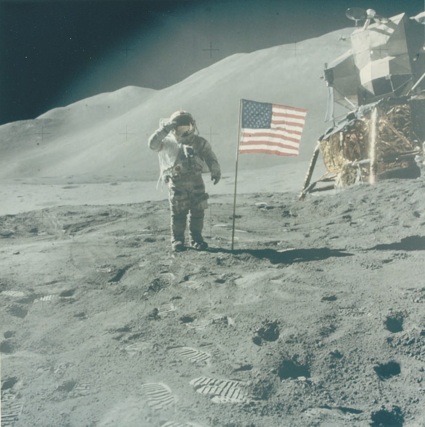 Astronaut David Scott gives salute beside U.S. flag, Apollo 15 Mission, August 1971