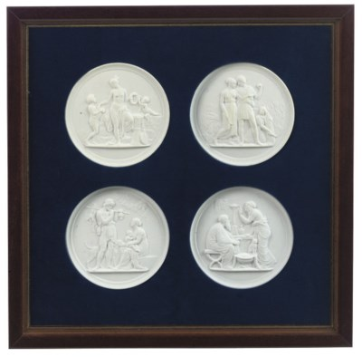 A SET OF FOUR RELIEF-MOULDED P
