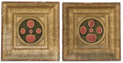A pair of framed red wax intag