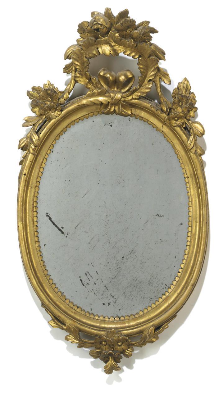 A giltwood oval mirror
