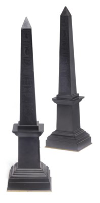 A pair of black marble obelisk