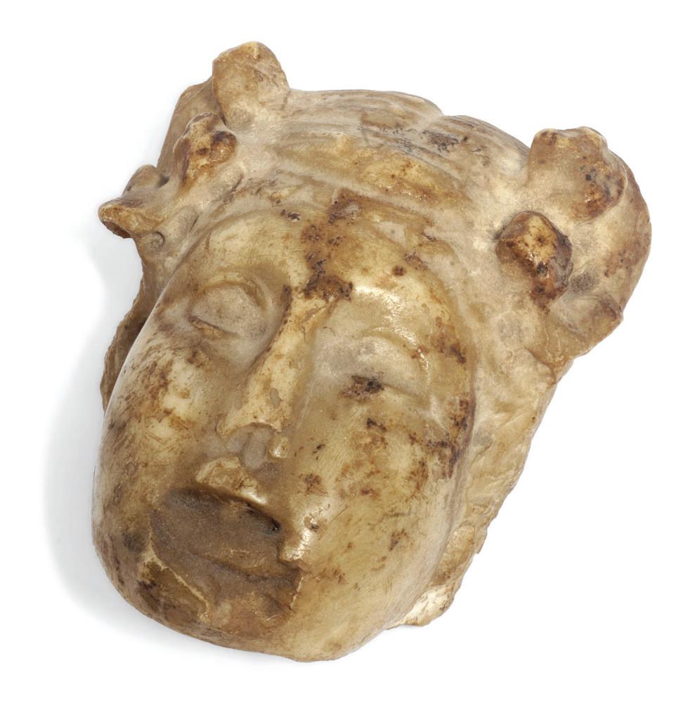 An antique white marble head f