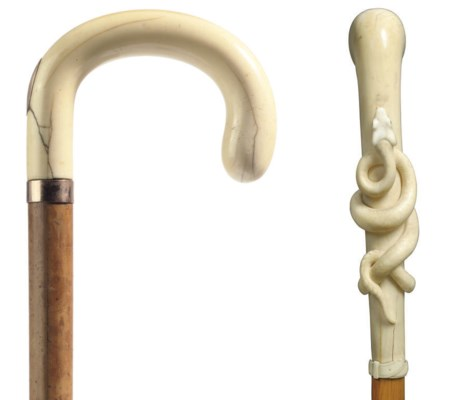 An ivory and gold crook-handle