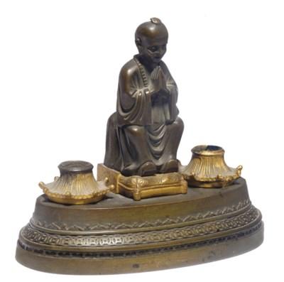 A Regency bronze inkwell