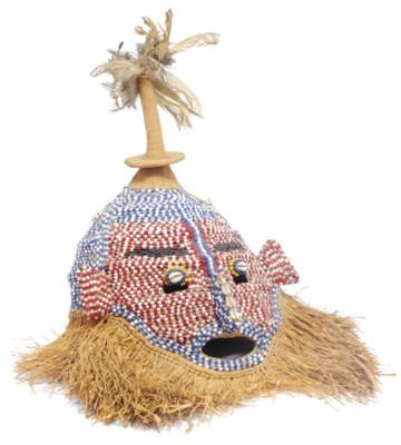 A straw and beadwork tribal ma