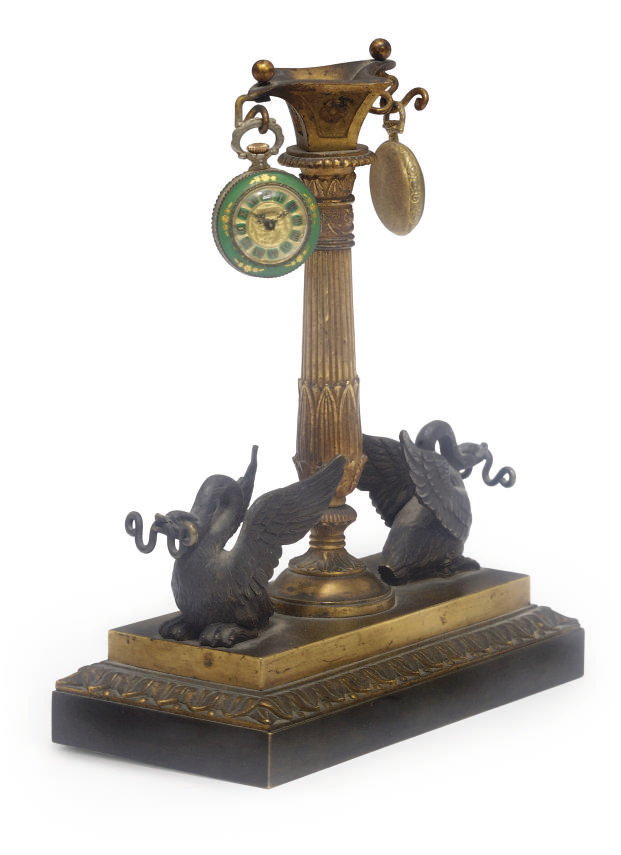 An Empire ormolu watch stand