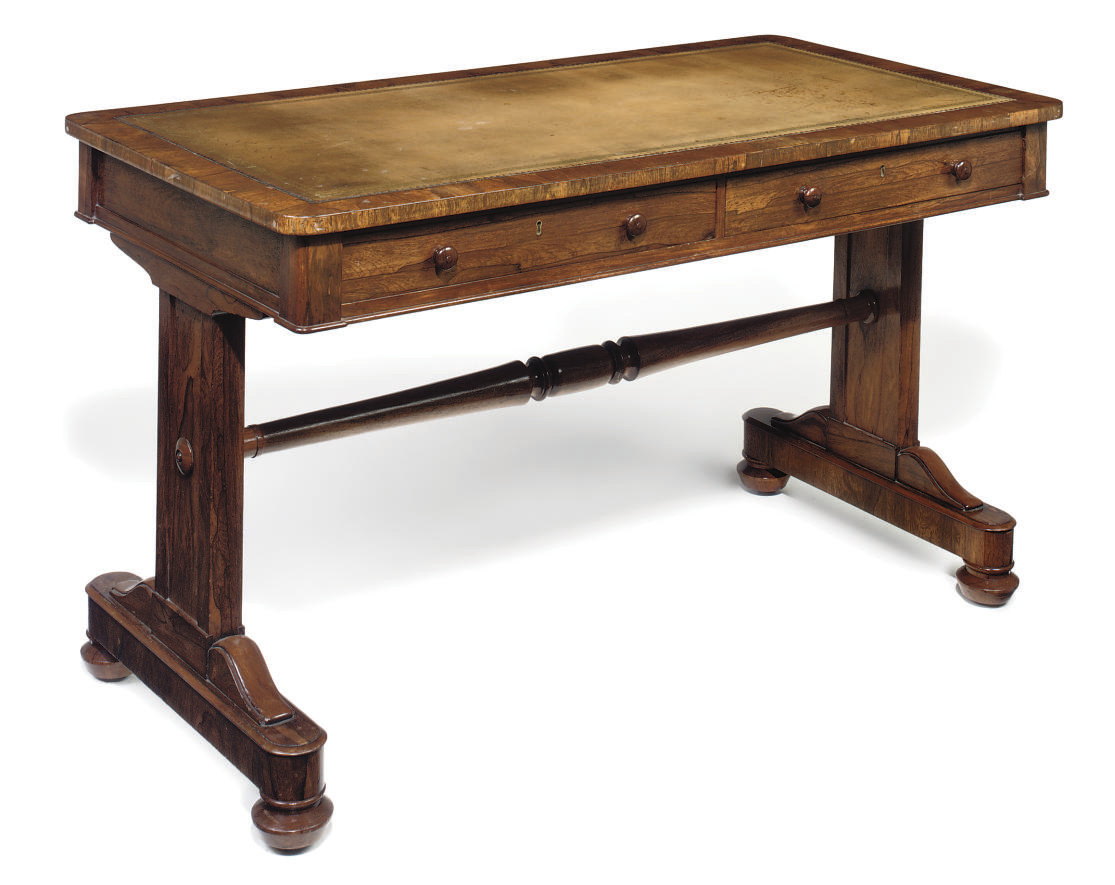 A LATE REGENCY ROSEWOOD LIBRARY TABLE