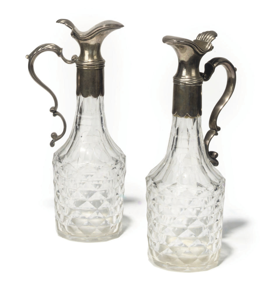 A PAIR OF SILVER-PLATE-MOUNTED CUT-GLASS OIL AND VINEGAR EWERS