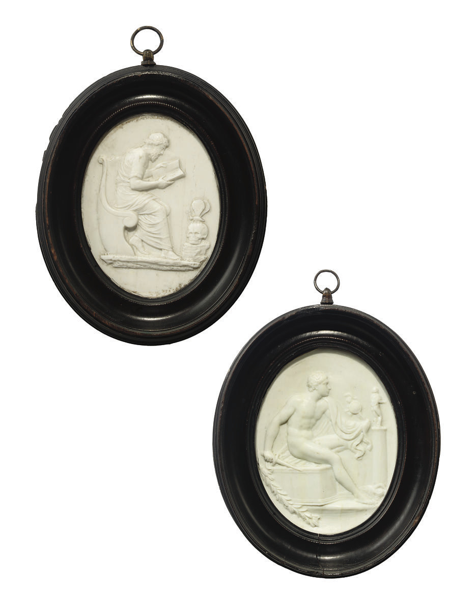 A PAIR OF OVAL COMPOSITION PASTE PLAQUES