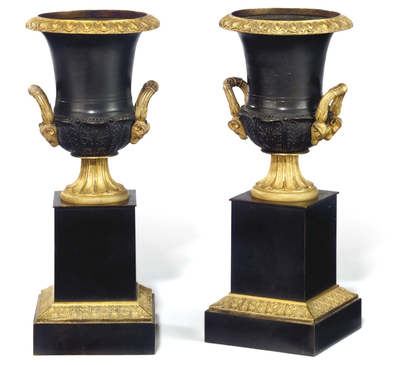 A PAIR OF RESTAURATION GILT AND PATINATED BRONZE URNS