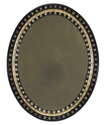 AN IRISH GLASS-MOUNTED EBONISE
