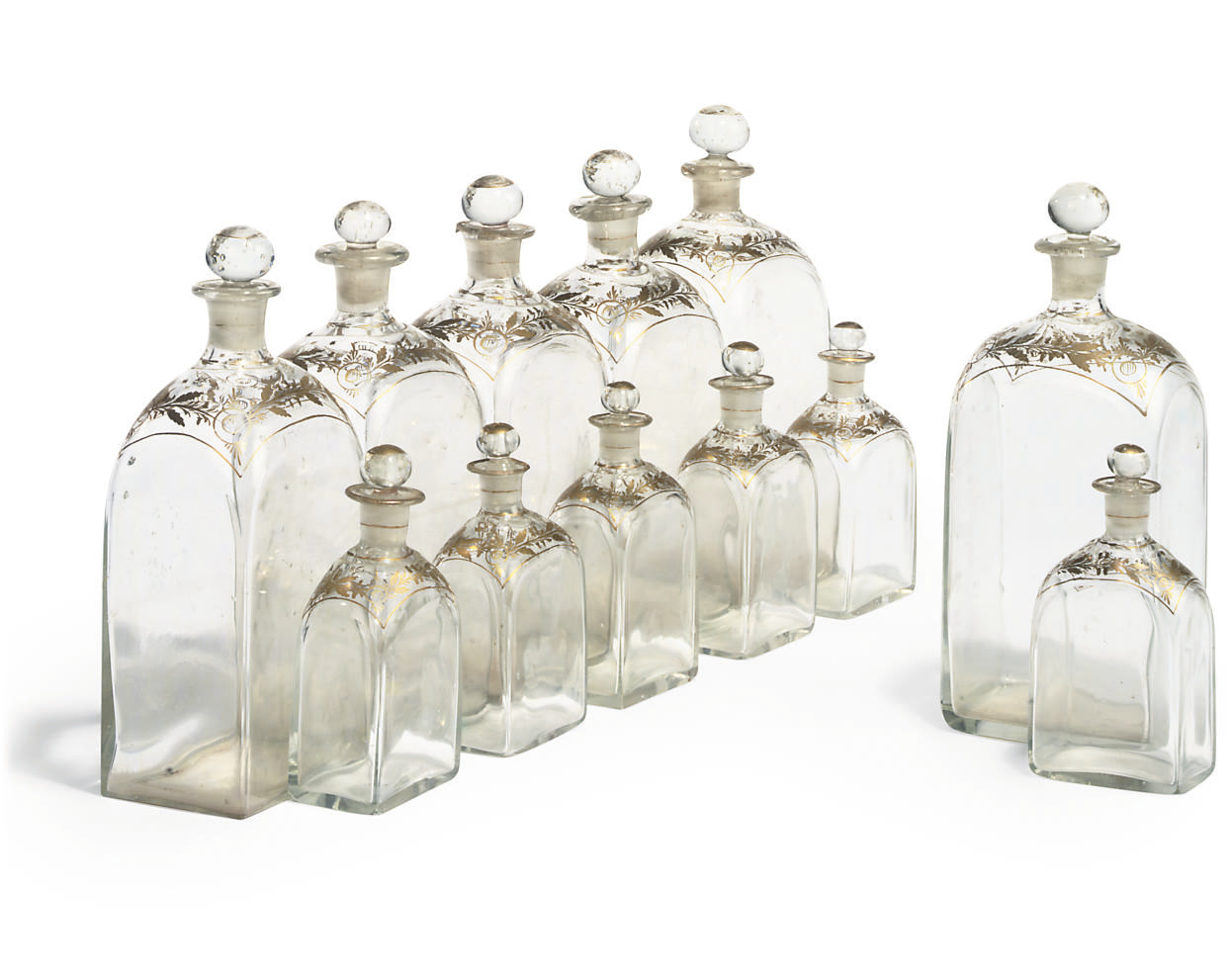 A SET OF CONTINENTAL GLASS TRAVELLING FLASKS