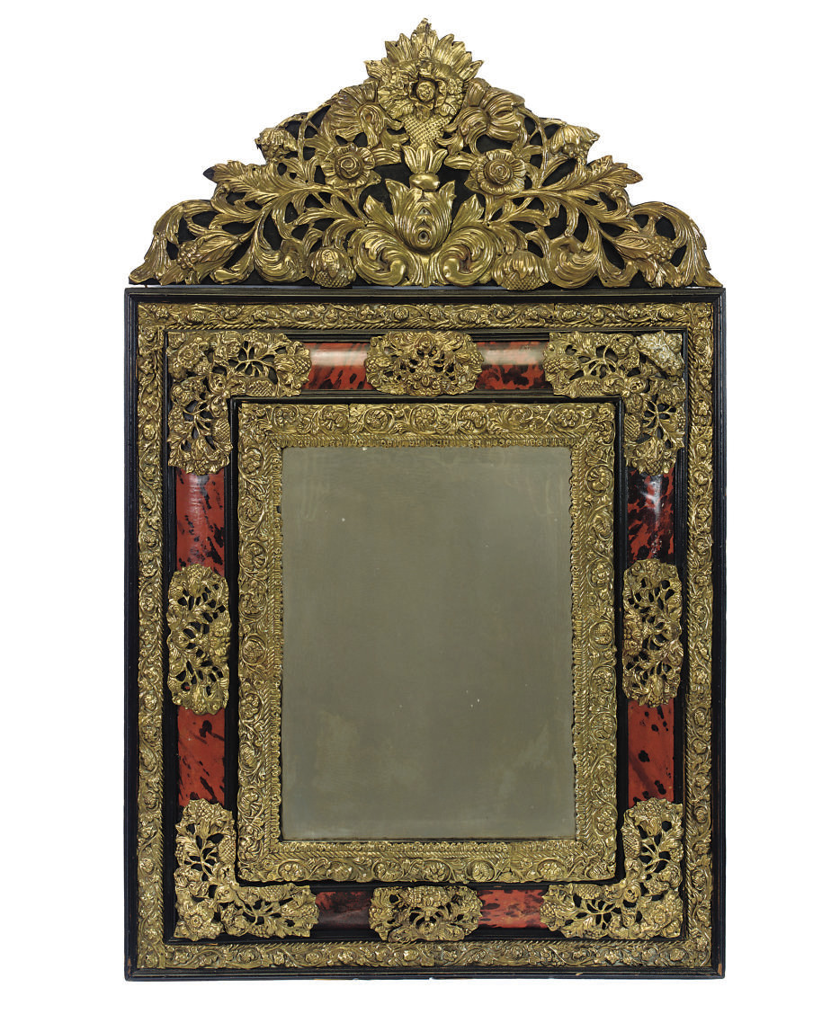 A DUTCH REPOUSSE BRASS AND SIMULATED RED TORTOISESHELL MIRROR